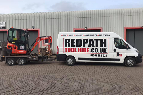 An image of the Redpath Tool Hire van moving a digger
